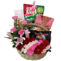 Basket arrangement of chocolates and flowers. Free delivery in Manila, Makati, Taguig, Paranaque. Guaranteed fresh by reliable Philippine flower shop.