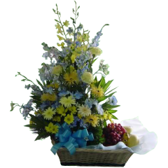 spring flowers with carnations and gerberas arranged in a basket with fresh fruits. Free delivery within Metro Manila by Philippine flower shop located in Makati City