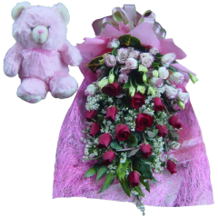 Beautiful arm bouquet of 12 red roses and lisianthus with 10 inch teddy bear flower delivery Philippines. Makati florist